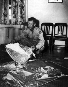 Jesse Marcel with foil type material recovered from the Roswell crash.