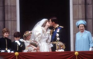 Image showing Princess Diana and Prince Charles kissing on the balcony at Buckingham Palace after their wedding.