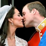 Kate and William kissing on the balcony of Buckingham Palace.