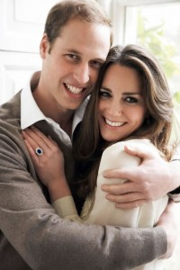 Photograpgh of William and Catherine with the engagement ring clearly visible. The white gold ring has a blue sapphire center and is surrounded by 14 diamonds.
