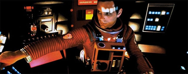 "Operating a spaceship in the film, ""2001: A Space Odyssey""."