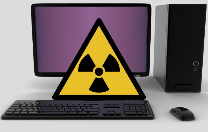 Radiation warning sign on desktop computer.