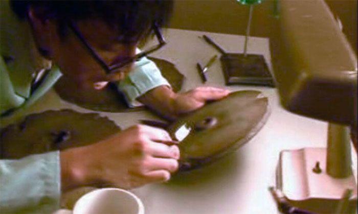 Professor Tsum Um Nui analyzing the stones (reconstruction).