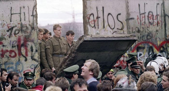 Berlin wall falling.