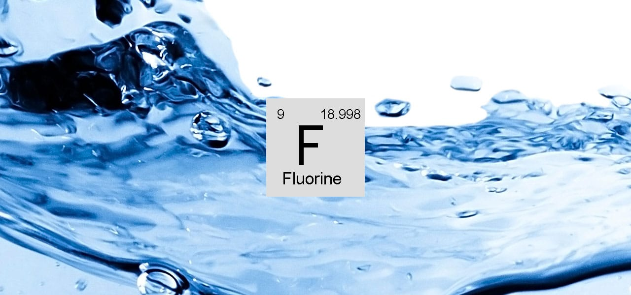 Image showing water and the Fluorine extract from the Periodic Table.