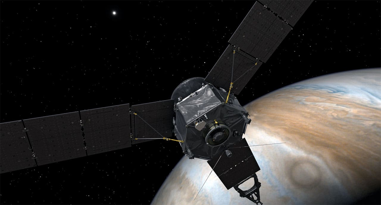 Juno spacecraft flying by the planet Jupiter.