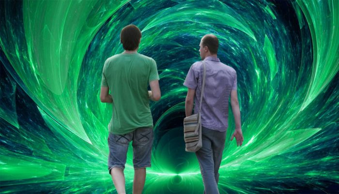 Two people walking into a portal.