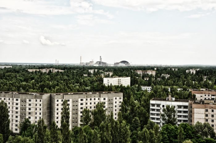 Pripyat with Chernobyl in the background