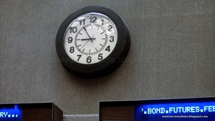 A still from the movie showing the hands of the clock at 9 and 11