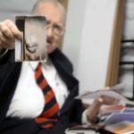 Boyd Bushman holding a photo of an alien life form.
