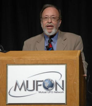 Dr. Roger Leir speaking at a conference.
