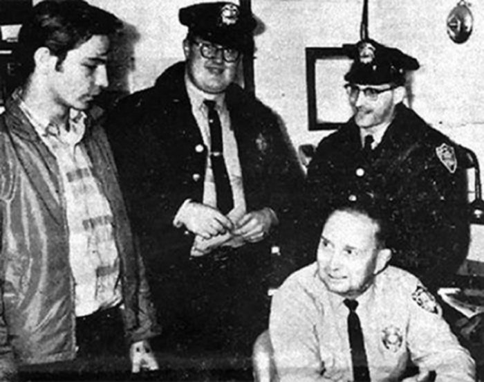 Normal Muscarello (left) with police officers