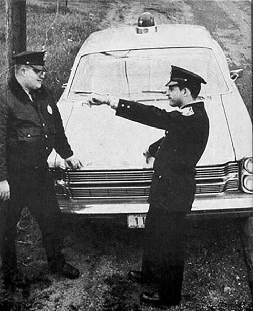 Officers David Hunt and Eugene Bertrand.