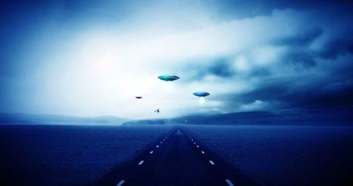 Artist's impression of an alien abduction over a road.