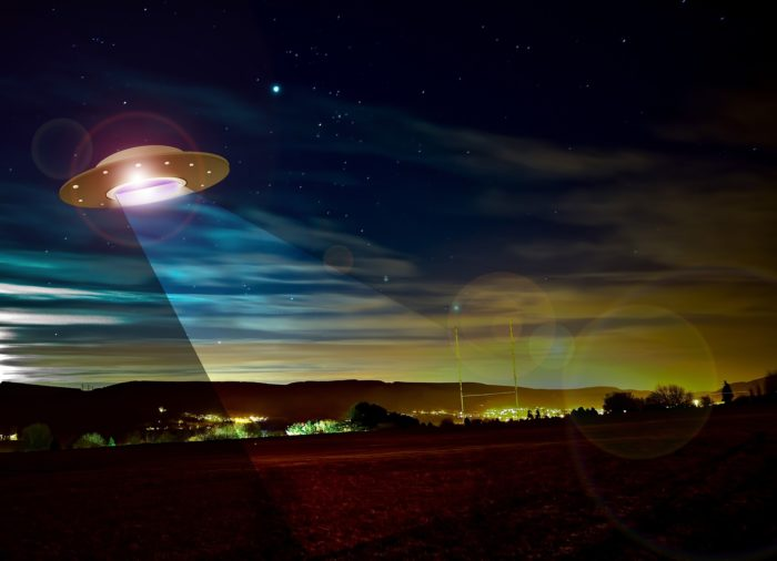 Artist's impression of a UFO hovering over a field