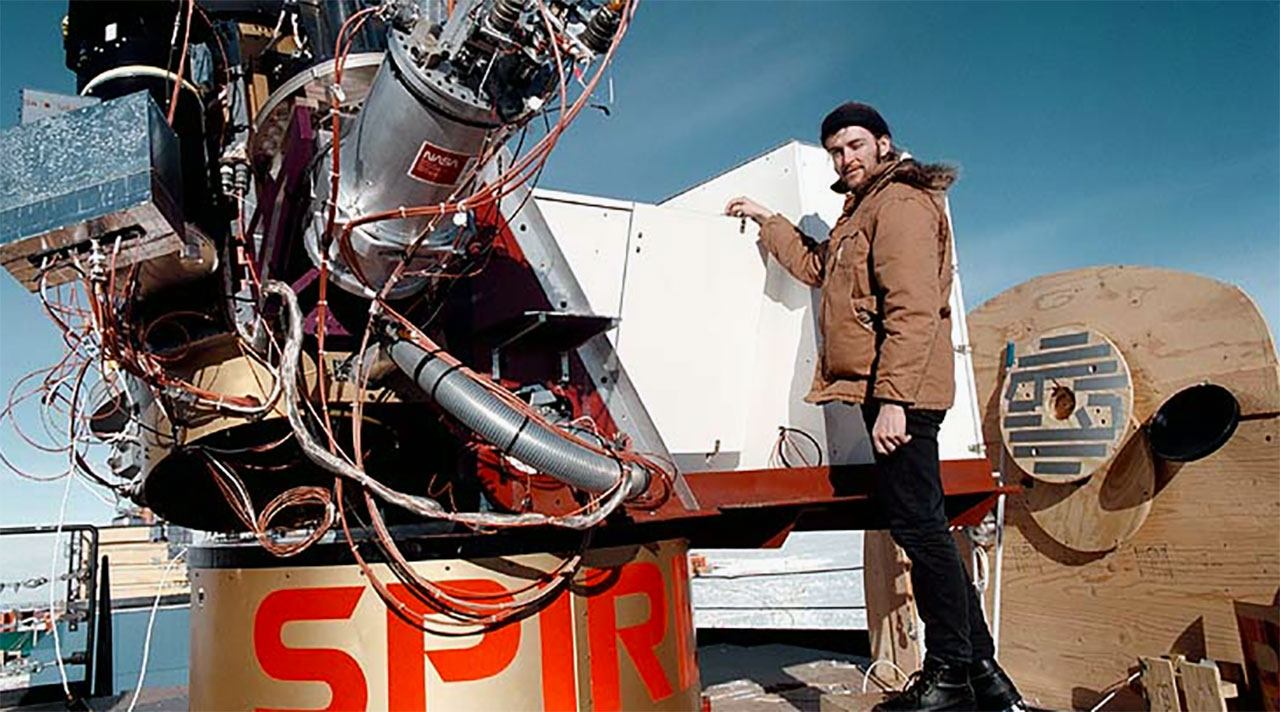 Rodney Marks standing by a telescope in Antarctica before his death.