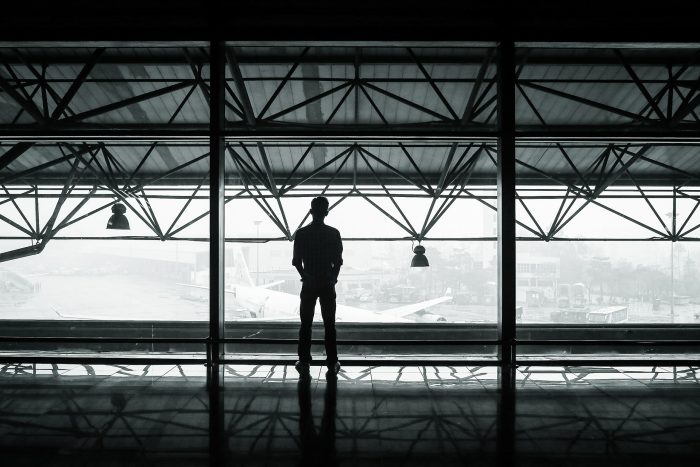 A dark figure looking out from Airport Stranded