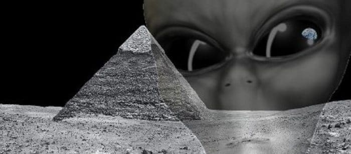 A depiction of a pyramid on the Moon with an alien face superimposed over the top