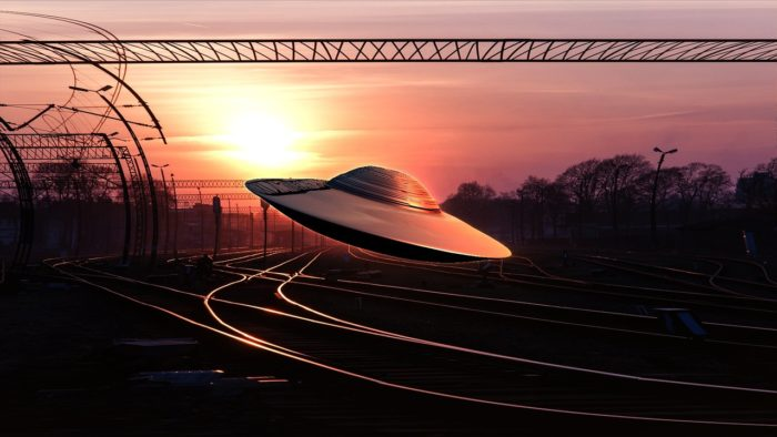 A depiction of a UFO over rail tracks
