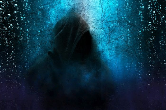 A depiction of a hooded figure