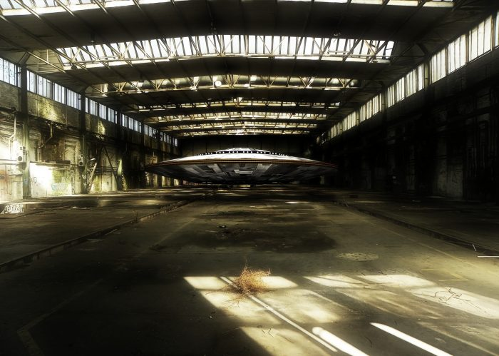 A depiction of a UFO in an aircraft hangar