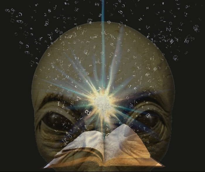 A picture of the Bible with an alien face superimposed underneath