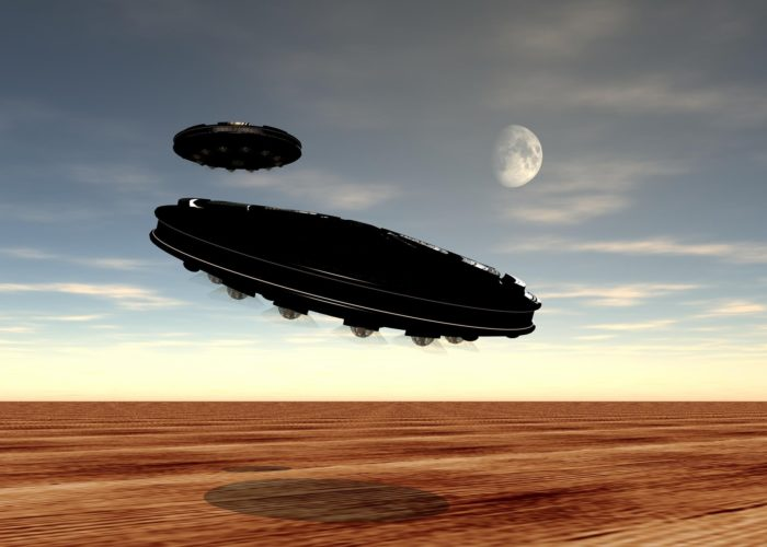 A depiction of UFOs flying over a desert