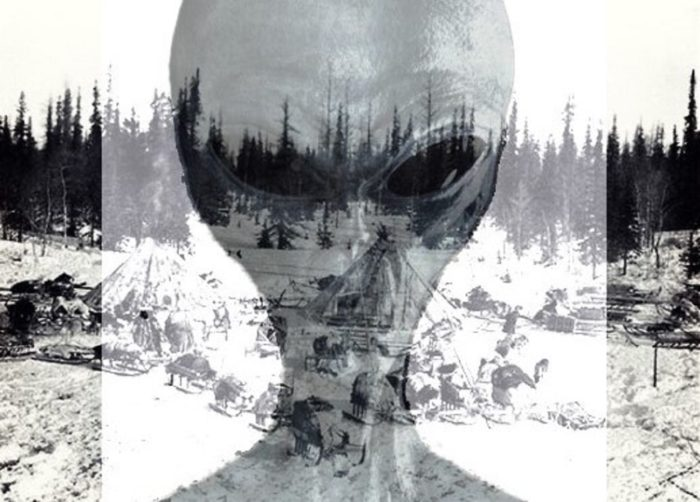A alien face superimposed of an abandoned village