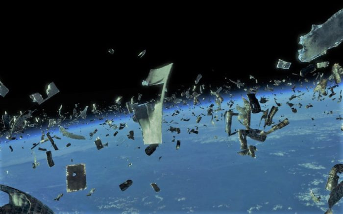 A depiction of vast amounts of space debris above the Earth