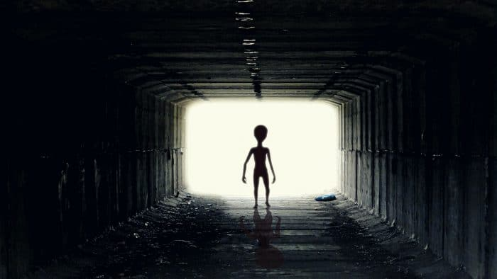 A depiction of an alien in a tunnel