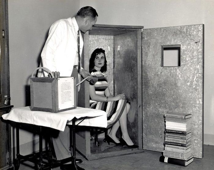 A volunteer lady sat inside the Orgone Accumulator