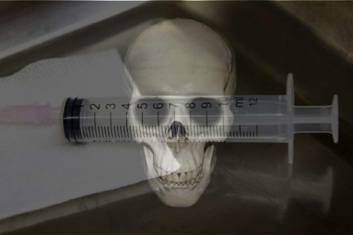 A picture of a medical needle with a skull superimposed underneath