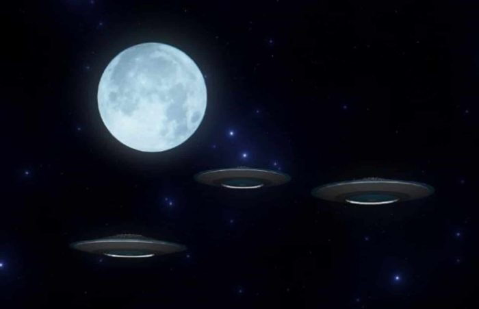 A depiction of UFOs under the moonlight