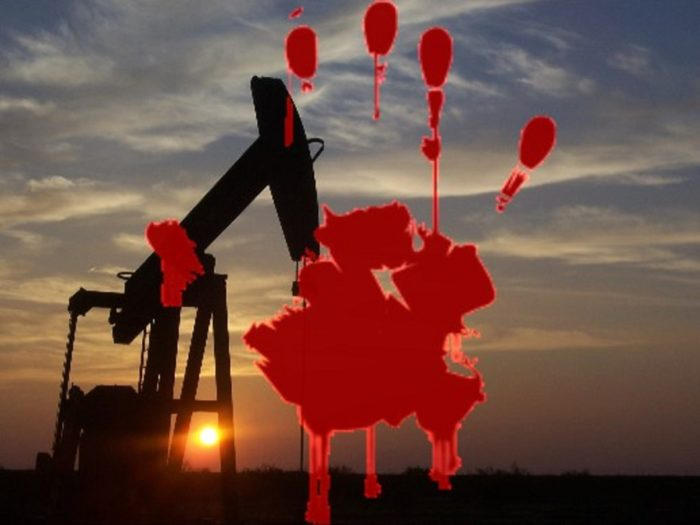 Oil Drill with a bloody handprint superimposed