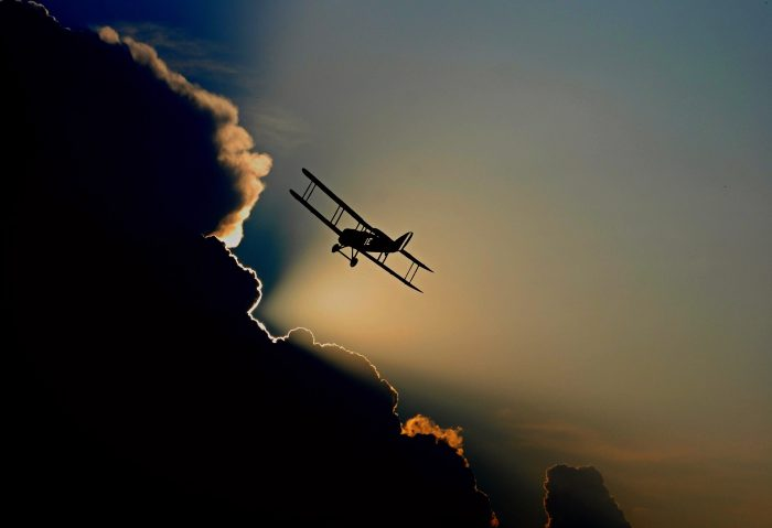 Picture of a plane approaching a cloud