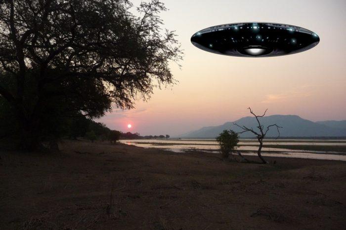 A superimposed UFO over a lakeside