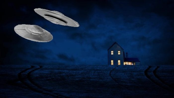 A depiction of two UFOs over a French farmhouse