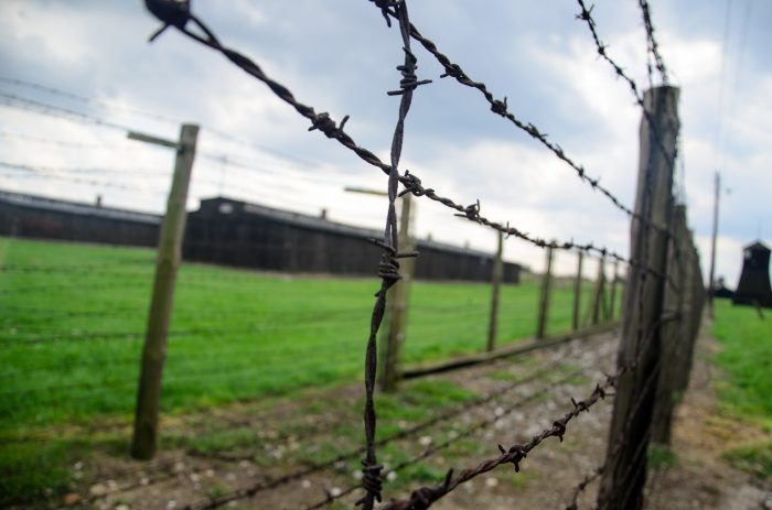 A close-up of the barbed wire fence of a Labor camp