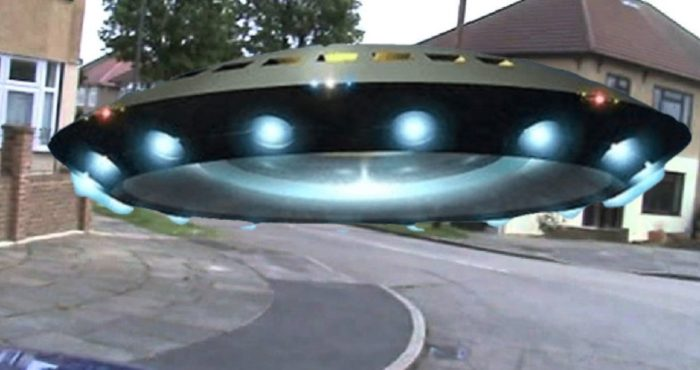 A depiction of a UFO over a UK housing estate