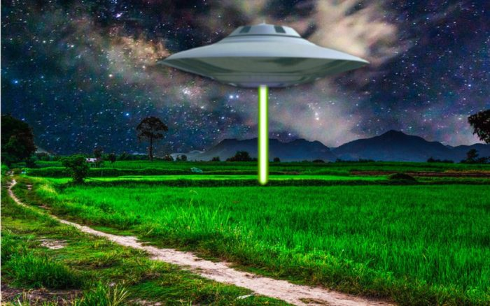 Depiction of a UFO shining a light beam to the ground