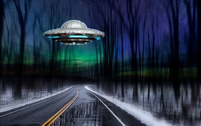 A depiction of a UFO over a cold icy road