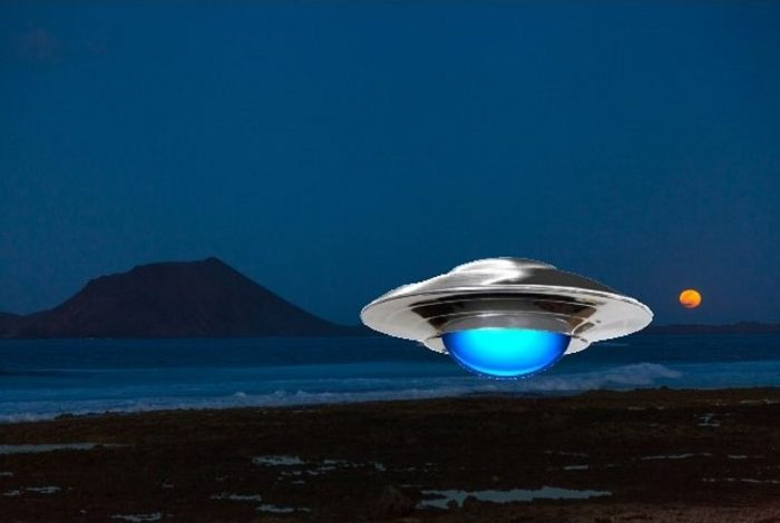 A depiction of a UFO hovering over the coast