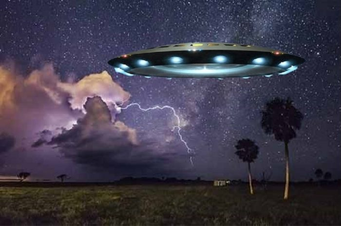 A depiction of a UFO over Florida at night