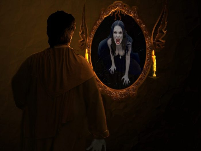 A picture of a man looking into a mirror with a vampire woman looking back