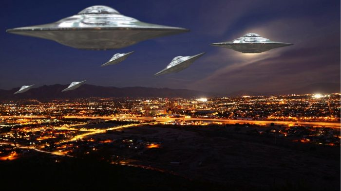 Several superimposed UFOs over an aerial night shot of Arizona