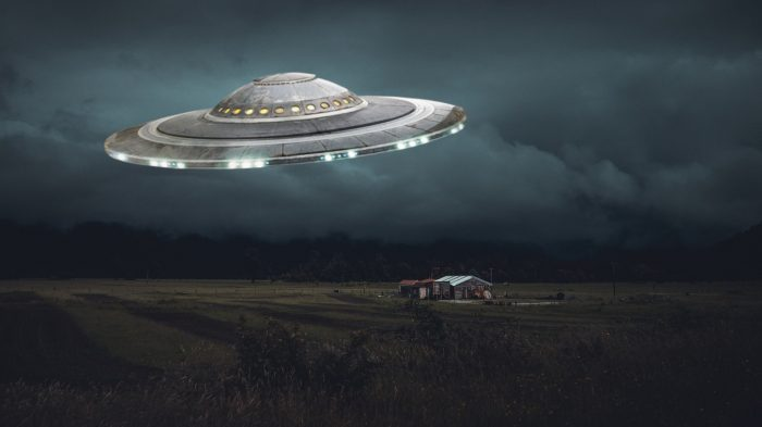 A depiction of a UFO over farm house