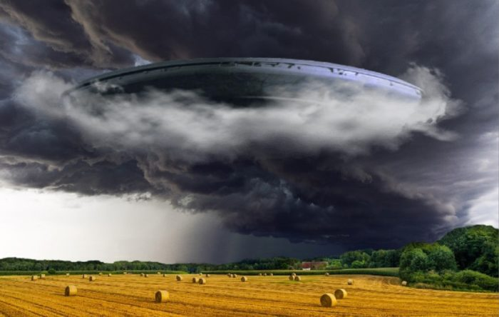A depiction of a UFO over a wheat field