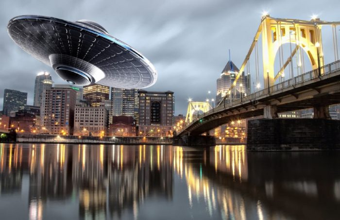 A depiction of a UFO over a river in Pittsburgh