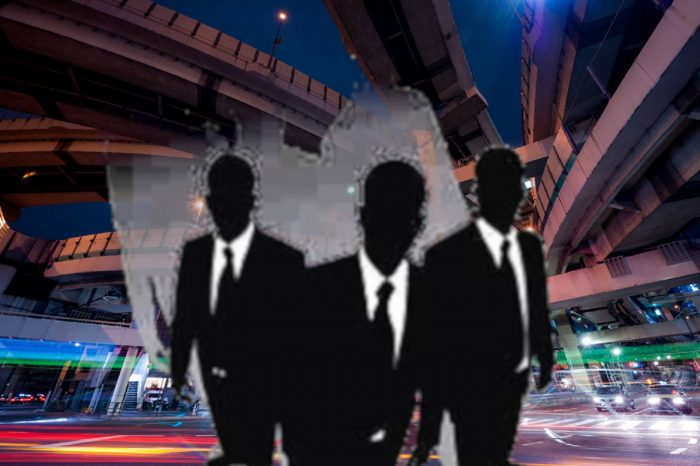Superimposed Men In Black over a picture of Tokyo