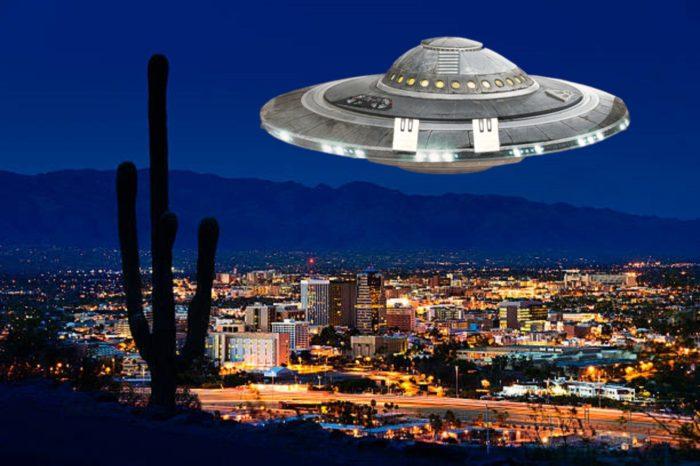 A superimposed UFO over a night scene of Arizona